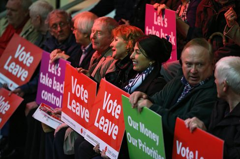 Supporters of the Vote Leave campaign attend a speech by London Mayor Boris Johnso in Manchester on April 15.