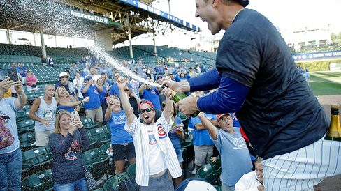 Anthony Rizzo #44 of the Chicago Cubs celebrates with fans after clinching their wildcard playoff position at Wrigley Field on Sept. 26, 2015 in Chicago, Illinois.
