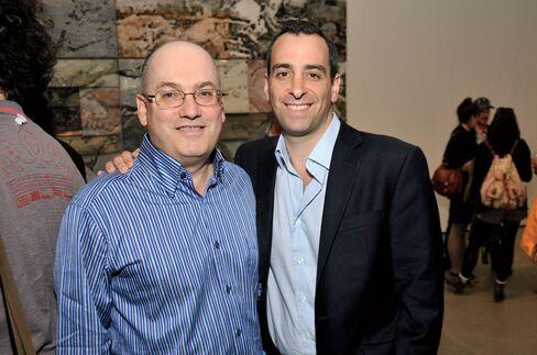Hedge fund billionaire Steven A. Cohen, left, and art adviser Sandy Heller attend a gallery reception in 2011.