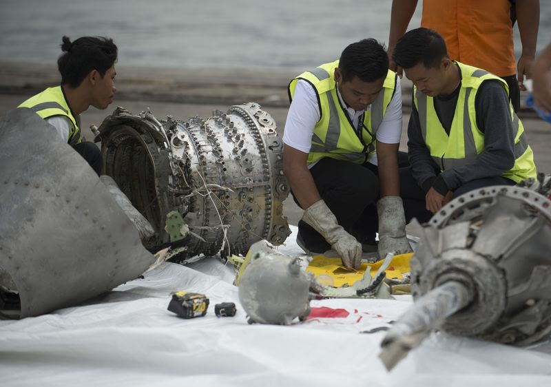 Investigators examine engine parts from Lion Air flight JT 610, Nov. 2018.