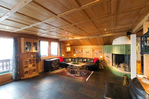 A wooden cart sits inside the living area of the Residenz Salzgaebe residential property in Davos, Switzerland, on Tuesday, Jan. 12, 2015.