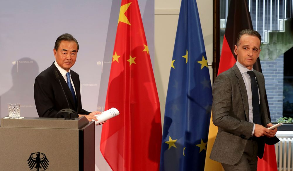 Wang Yi and Heiko Maas leave after a joint press conference in Berlin, on Sept. 1.