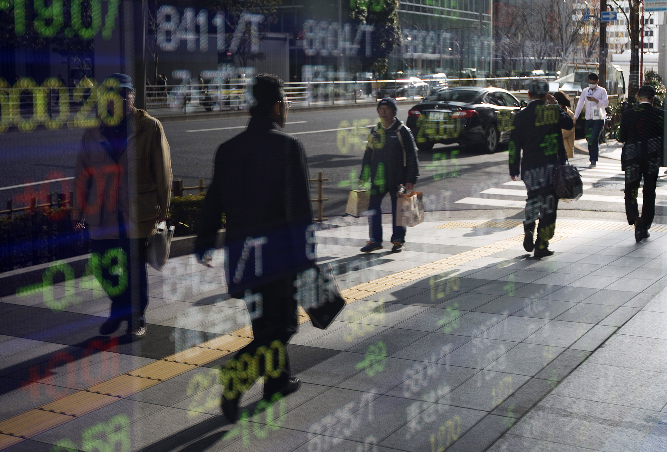 Asia Stocks Mixed, Oil Touches $60, Bitcoin Dips: Markets Wrap