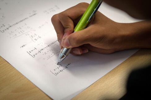 A student studies during a maths class.