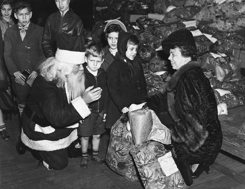 Eleanor Roosevelt And Santa Claus Giving Presents In Washington on December 23, 1939