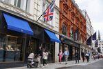 Shoppers pass luxury stores on New Bond Street in London, U.K., on Wednesday, Aug. 18, 2021. U.K.