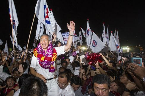 Lee Hsien Loong, Singapore's prime minister, celebrates with People's Action Party (PAP) supporters at an election results rally in Singapore in September. Photographer: Nicky Loh/Bloomberg