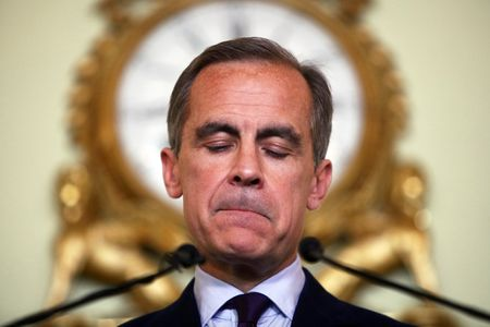 Bank of England Governor Mark Carney reacts during a news conference in the City of London.