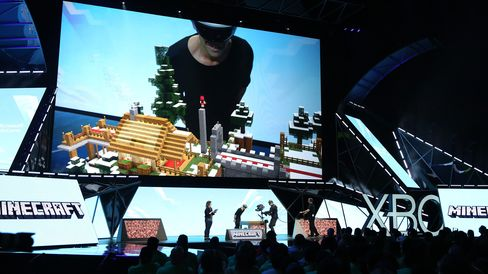 Lydia Winters, brand directorfor Mojang, and Saxs Persson, studio manager for Microsoft, show Minecraft built specifically for Microsoft HoloLens at E3 2015 on June 15 in Los Angeles.