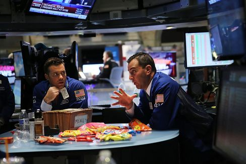 Traders wait on a nearly empty trading floor at the New York Stock Exchange (NYSE) after trading was halted due to a 'technical glitch' on July 8, 2015 in New York City.