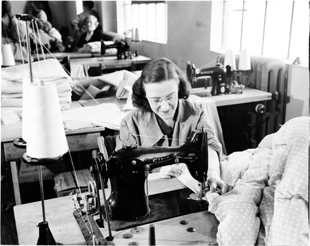 Sewing a quilt, 10th Avenue and 36th Street, 1937.