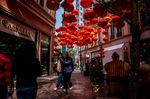 Pedestrians walkunder lanterns ahead of the lunar New Year in Hong Kong.