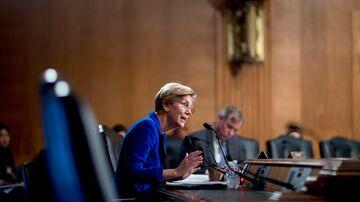 Senator Elizabeth Warren speaks at a Senate Banking Subcommittee hearing in Washington on Nov. 21, 2014.