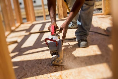 The S&P 500 Index rose 0.5 percent on Monday as data showing strong confidence among U.S. homebuilders helped reverse earlier losses spurred by weak manufacturing in the New York region.