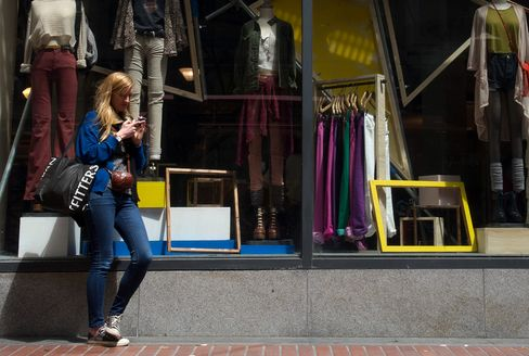 A woman stands outside an Urban Outfitters store in San Francisco.