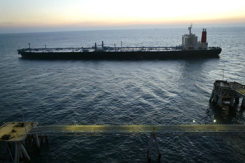 A tanker leaves the Basra Oil Terminal in the Gulf 50kms south of Iraq Sunday December 7, 2003.