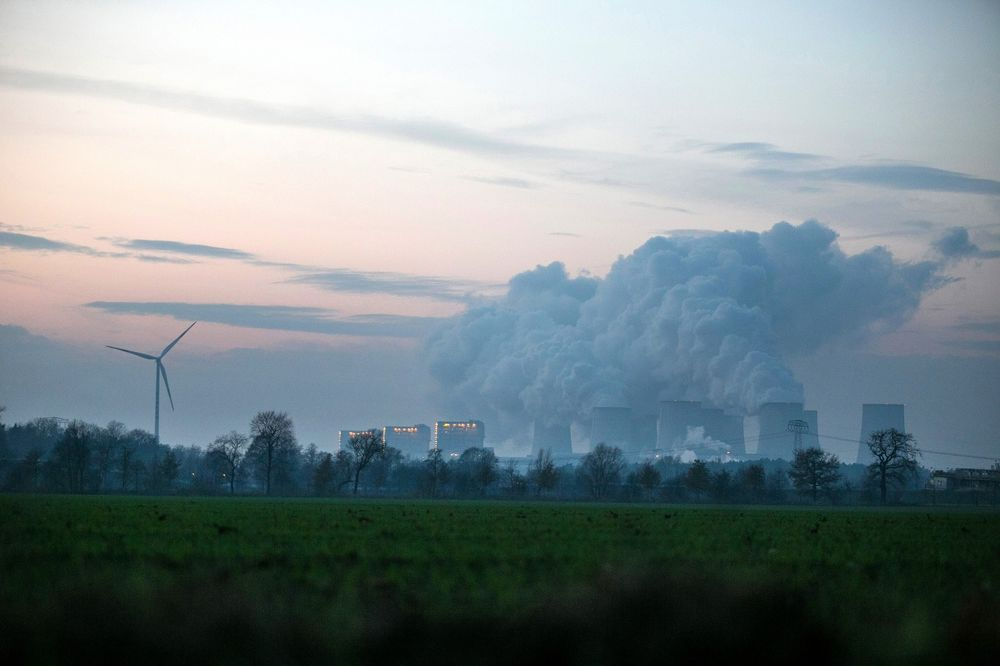 Merkel Forms 'Climate Cabinet' as Carbon Pollution Fines Loom