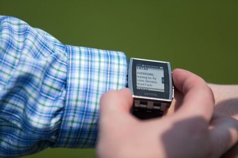 A no-fly zone alert appears on an operator's smartwatch
