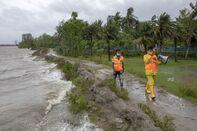 Volunteers of Cyclone Preparedness Programmer walk use a
