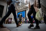 Pedestrians pass in front of the New York Stock Exchange (NYSE) in New York.