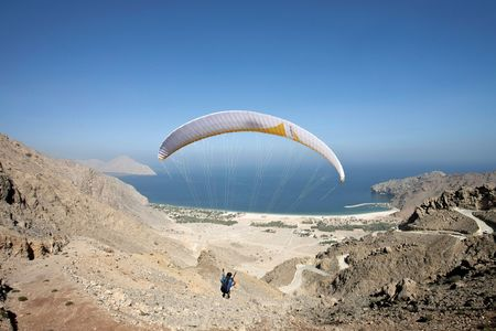 Paragliding to the Six Senses Zighy Bay.