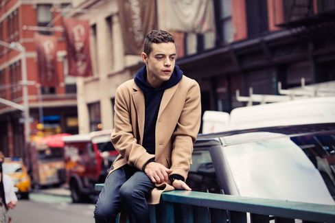 """Once I kinda got my legs under me and felt like I knew this guy [Elliot], I began to ask less questions and I wanted fewer answers."" On Malek: Massimo Alba cashmere hoodie, $840; Jil Sander camel overcoat, $2,935; J Brand Tyler slim-fit jeans, $228; Hamilton Jazzmaster GMT, $1,495."