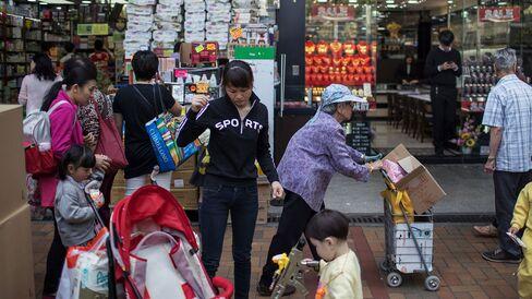 Shoppers in the Sheung Shui district, Hong Kong, China.