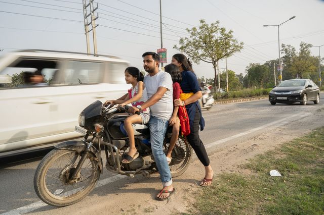 Ravi Kant Sharma with his wife and daughters in Bahadurgarh. According to Pew Research Center, India's middle class shrank by 32 million people in 2020.