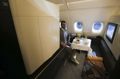 "A journalist sits in one of the first class ""Apartments"" on the Etihad Airways Boeing B787."