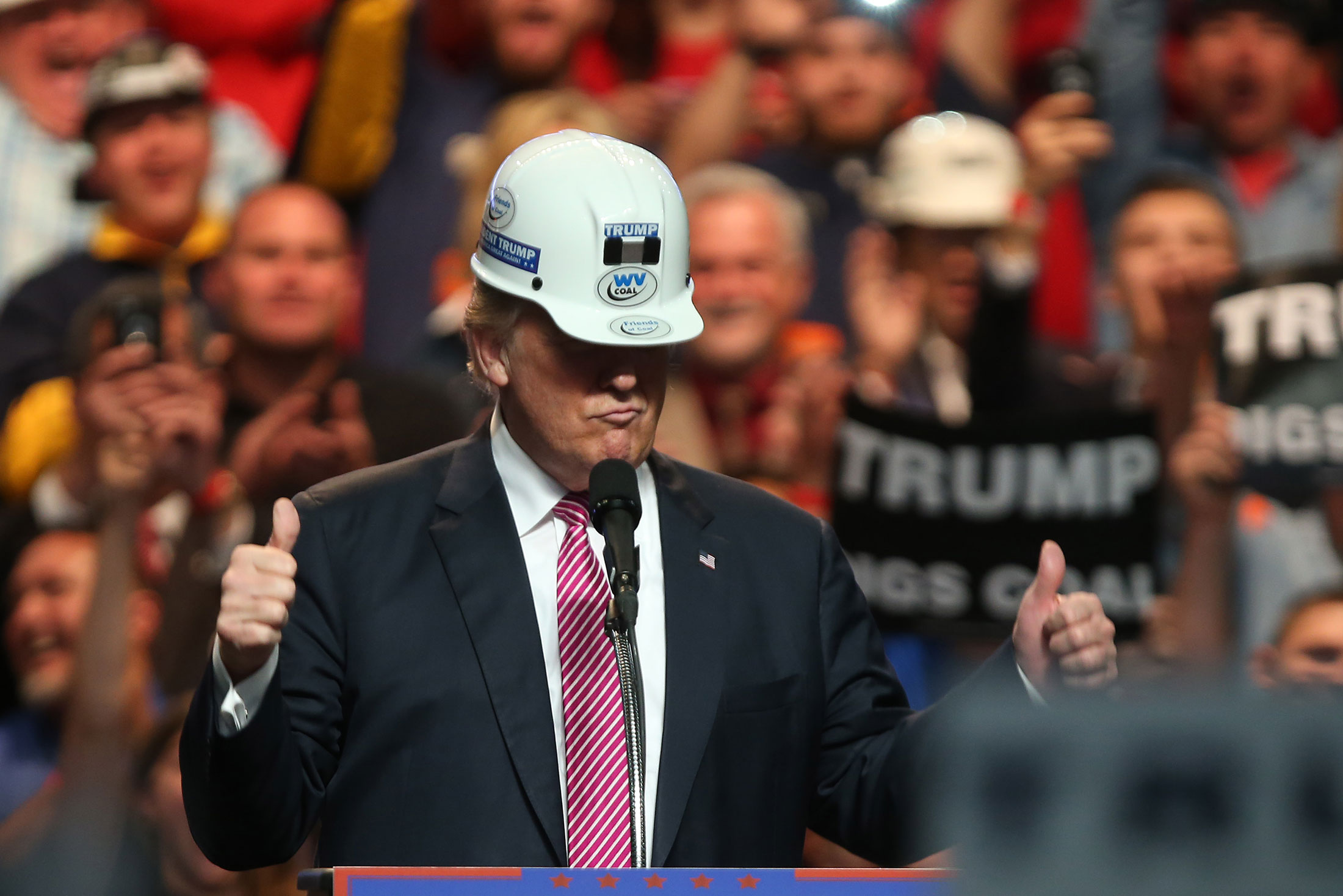 Donald Trump models a hard hat in support of miners during a rally at the Charleston Civic Center in Charleston, West Virginia.