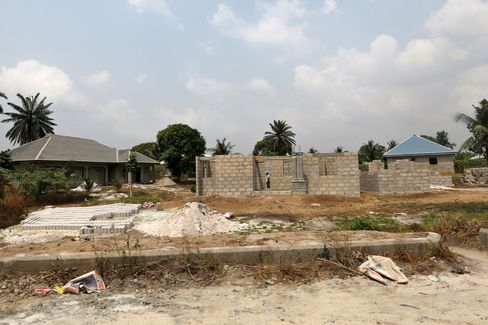 Unfinished new houses stand in Bodo.