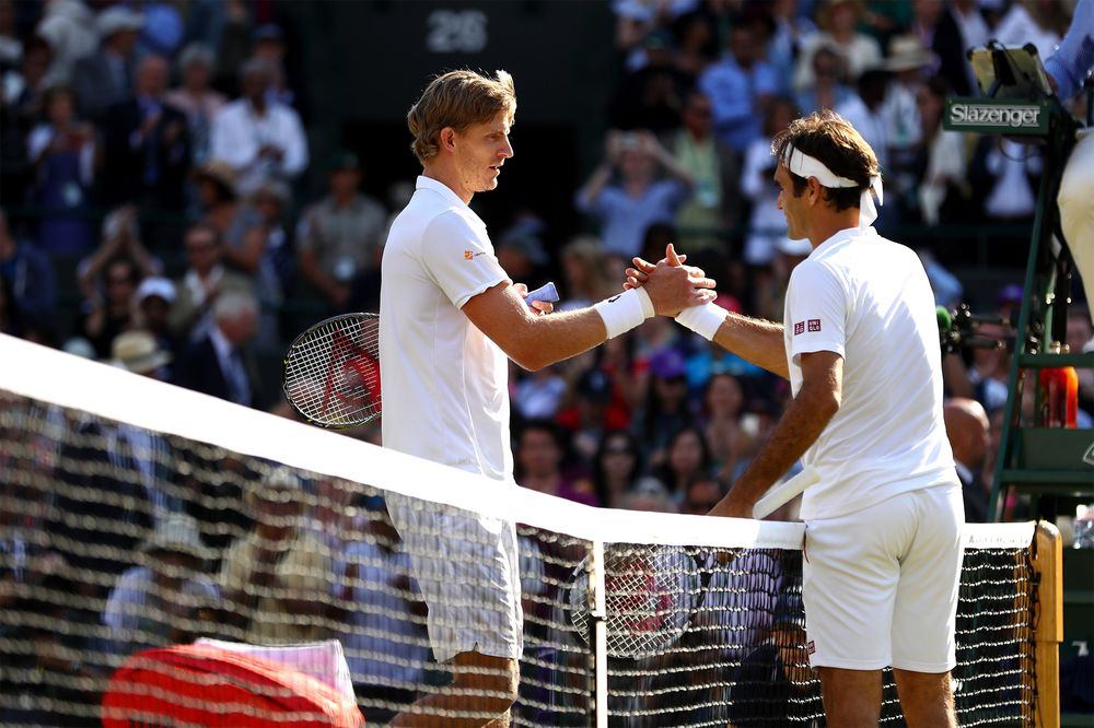 check out d386b 7f97a Kevin Anderson of South Africa and Roger Federer of Switzerland embrace at  the net following their