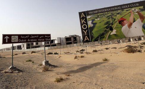 Donald Trump is shown playing golf on a billboard at the Trump International Golf Club Dubai on Aug. 12,