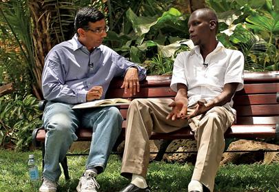 D???Souza (left) interviews President Obama???s half-brother in Kenya