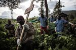 Health workers carry a coffin containing a victim of Ebola virus on May 16, 2019 in Butembo, Democratic Republic of Congo..
