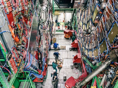 Workers perform maintenance on the Compact Muon Solenoid detector, which, like Atlas, was used to search for the Higgs boson. Next up: The hunt for particles of dark matter, the mysterious stuff that makes up 80 percent of galaxies' mass.