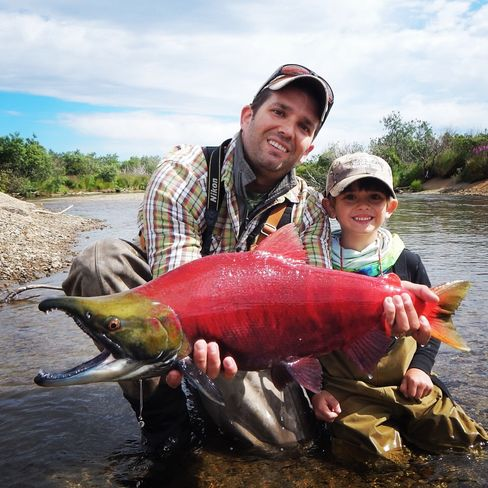 Donald Trump, Jr. and one of his sons with a Sockeye salmon in Alaska in summer 2014.