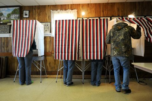 Voters cast their ballots at the WCR Hall November 6, 2012 in Macksburg, Iowa.