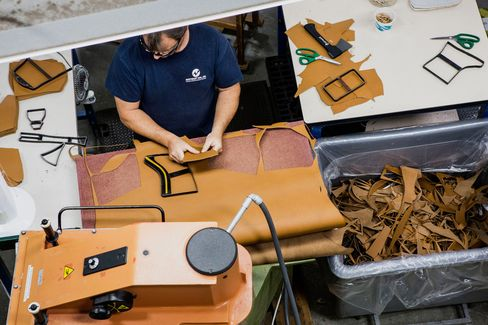 A worker cuts patterns on leather for boots at L.L. Bean's factory in Brunswick, Maine. Good luck with that.
