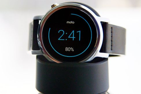 The Moto 360 becomes an alarm clock when it's charging on the included magnetic cradle.