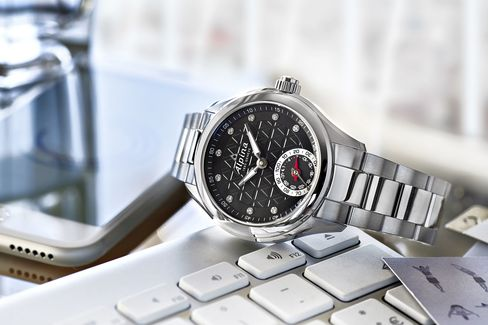 An Alpina smartwatch, with diamonds and a steel bracelet.