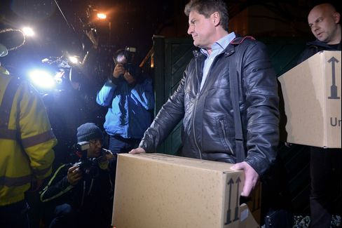 Investigators Carry Boxes From The Apartment Of Andreas Lubitz