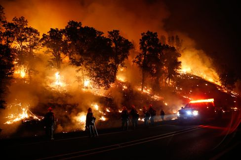 The Valley Fire, which started on Sept. 12, burned wineries to the ground. Here, firefighters combat a backfire on Sept. 13, 2015.