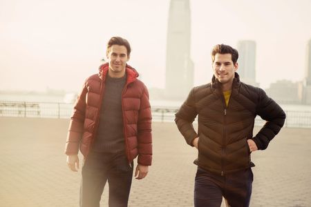 On Moore: (Here) Down jacket by Moncler via Mr Porter ($1,230); sweater by Bonobos ($108). (Above) Peacoat by Ermenegildo Zegna ($3,495); sweater by Ermenegildo Zegna ($1,295); jeans by Joe's Jeans (Moore's own). On Henrique: (Here) Down jacket by Z Zegna ($1,095); sweater by Z Zegna ($445). (Above) Coat by Theory ($1,295); shirt by Theory ($195); pants by AG Jeans ($178).