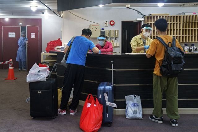 Crew members check in ahead of their deployment on a bulk carrier. Seafarers come from China, India, the Philippines and elsewhere to meet their ships.