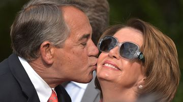 House speaker john boehner kisses house minority leader nancy pelosi during a reception for supporters of h.r. 2, the medicare access and chip reauthorization act 2015, in rose garden white on april 21.