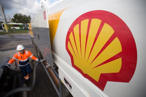 A fuel tanker truck delivers petrol to a gas station operated by Royal Dutch Shell Plc in Moscow, Russia, on Sept. 30, 2014.