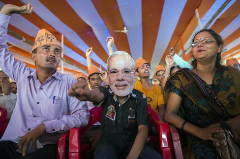 A supporter of the Bharatiya Janata Party wears a Narendra Modi mask during a rally in Bihar last year.