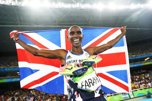 Mo Farah celebrates after winning gold in the men's 5000 meter final.