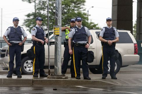 Police officers stand near a restricted security zone